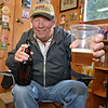 "(Brad Davis/The Register-Herald) Relatively new home brewer James Bogle, only four years into the hobby, has already turned out some quality batches, such as his ""American Pale Ale,"" which he pours a cup of Sunday afternoon in friend and fellow beer lover Dave Bieri's garage Sunday afternoon. He describes it as an ""old time"" recipe that dates back to around the late 1800's."