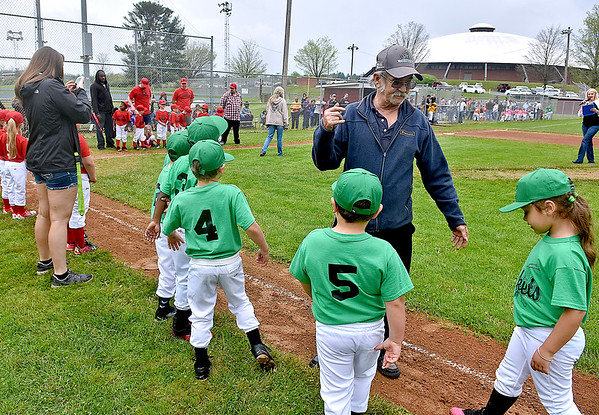 (Brad Davis/The Register-Herald) 32-year Beckley Little League volunteer Mike Donell, right, directs young ball players where to line up as their names are called during team introductions, part of Beckley Little League's Tee Ball Opening Day ceremonies Saturday afternoon.