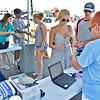 (Brad Davis/The Register-Herald) Attendees make their way inside as employee Jerri Dowdy, far right, scans tickets during the opening day of the State Fair Thursday afternoon.