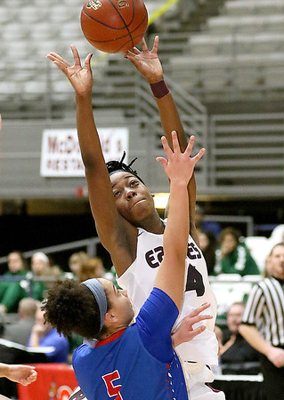 (Brad Davis/The Register-Herald) Woodrow Wilson's Sydni Darden drives and scores against Morgantown during Big Atlantic Classic action Thursday night at the Beckley-Raleigh County Convention Center.