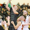 (Brad Davis/The Register-Herald) Wyoming East's McQuade Canada drives and scores as Independence's Jared Cannady defends Friday night in Coal City.