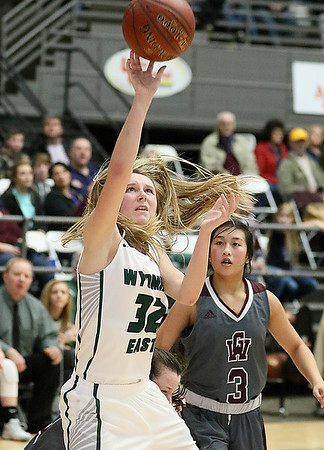 (Brad Davis/The Register-Herald) Wyoming East's Gabby Lupardus drives and scores as George Washington's Vivian Ho (#3) can only watch during Big Atlantic Classic action Saturday the Beckley-Raleigh County Convention Center.