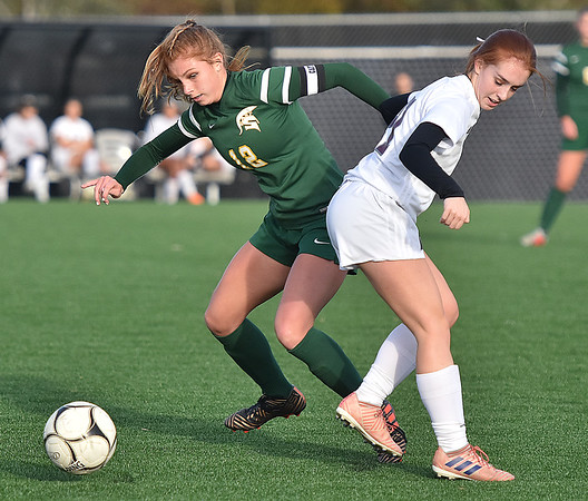 (Brad Davis/The Register-Herald) Greenbrier East's Emma Dotson battles for possession with George Washington's Morgan Holtsclaw Thursday evening at the YMCA Paul Cline Memorial Sports Complex.
