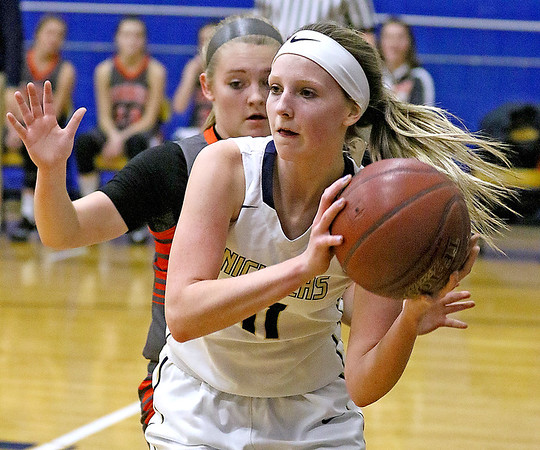 (Brad Davis/The Register-Herald) Nicholas County's Maggie Gadomski looks for an open teammate underneath as Summers County's Tiffani Cline defends Wednesday night in Summersville.