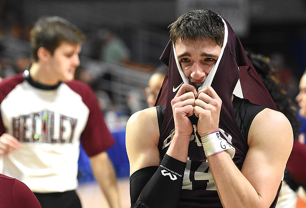 Bryce Radford, of Woodrow Wilson, covers his head with his jersey after losing to Martinsburg 58-48 during the quarter-final game of the Class AAA Boys State Basketball Tournament held at the Charleston Civic Center. Martingburg won 58-48<br /> (Rick Barbero/The Register-Herald)