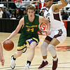 (Brad Davis/The Register-Herald) Greenbrier East's Logan Taylor drives into the lane as Woodrow Wilson's Isaiah Hairston defends Saturday night at the Beckley-Raleigh County Convention Center.
