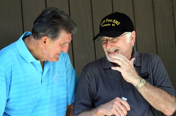 UMWA International President Cecil Roberts and Senator Joe Manchin hang out at the 80th annual UMWA Labor Day celebration in Racine Monday. (Jenny Harnish/The Register-Herald)