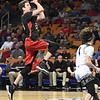 Thad Jordan, left, of Greater Beckley Christian, drives in for an easy layup against Tug Valley  during the quarter-final game of the Class A Boys State Basketball Tournament held at the Charleston Civic Center. Tug Valley won 83-52<br /> (Rick Barbero/The Register-Herald)