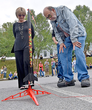"""(Brad Davis/The Register-Herald) """"Mrs. Gilligan"""" Dreama Denver and Rocket Boy Roy Lee Cooke make a quick final inspection prior to the rocket launching portion of events at the Rocket Boys Festival Saturday afternoon at the Exhibition Coal Mine."""