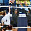 (Brad Davis/The Register-Herald) WVU Tech defenders Ana Monteiro, left, and Carolina Bologna block a spike attempt from Midway's Kylie Flatt Saturday afternoon in the Van Meter Gymnasium.