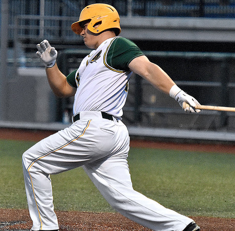 (Brad Davis/The Register-Herald) Miners hitter Brendan Mapes drives in teammate Mike Santaromita with a 2nd inning single against Butler Wednesday night at Linda K. Epling Stadium.