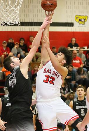 (Brad Davis/The Register-Herald) Oak Hill's Darrick McDowell drives to the basket as Westside's Corey Hatfield defends Friday night in Oak Hill.