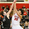 (Brad Davis/The Register-Herald) Oak Hill's Darrick McDowell drives to the basket as Westside's Corey Hatfield defends Friday night in Oak Hill.