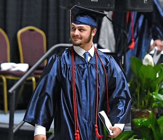 (Brad Davis/The Register-Herald) A pround Independence graduate looks towards friends and family in the stands Saturday morning at the Beckley-Raleigh County Convention Center.