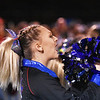 A Midland Trail cheerleader cheers on her side during their high school football game against Fayetteville Friday in Fayetteville. (Chris Jackson/The Register-Herald)