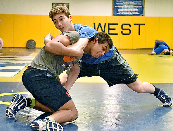 (Brad Davis/The Register-Herald) Greenbrier West's Trevor Edenfield works on moves as he grapples with teammate Mylik Cox during a practice Friday afternoon in Charmco.