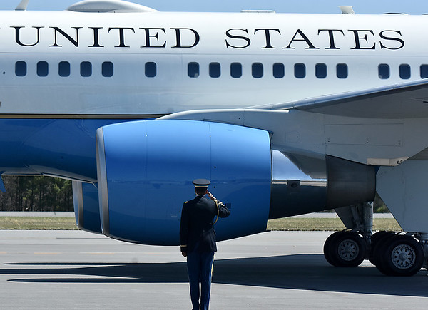 (Brad Davis/The Register-Herald) A military member salutes as Air Force One rolls to a park Thursday afternoon at Greenbrier Valley Airport.