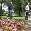 (Brad Davis/The Register-Herald) Phil Mickelson, right, smiles toward fans cheering him on as he and groupmate Kevin Kisner make their way to the no. 10 tee during opening round action of the Military Tribute at The Greenbrier Thursday afternoon in White Sulphur Springs.