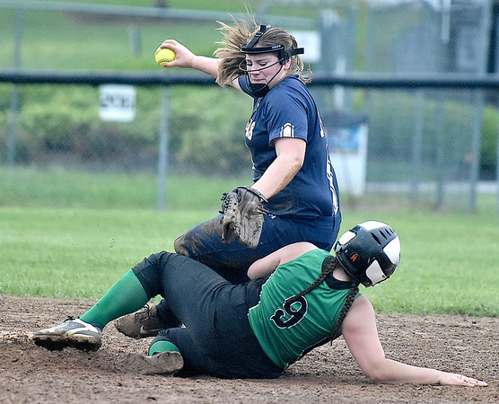 (Brad Davis/The Register-Herald) Greenbrier West infielder Reegan Lively gets taken out by Fayetteville baserunner Samantha Holbrook's slide into 2nd, breaking up a potential double play during the Cavaliers' rain-soaked thriller at Fayetteville Wednesday night.