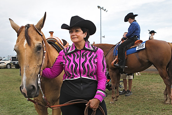 Sherry Breeden, of Covington, waits to compete in Western Pleasure Showmanship at the Open Horse Show at the State Fair of West Virginia Friday. (Jenny Harnish/The Register-Herald)