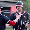 (Brad Davis/The Register-Herald) Greater Beckley Christian slugger Reece Standard is greeted with kudos at the plate after cranking the second of two home runs on the day against Charleston Catholic Tuesday evening.