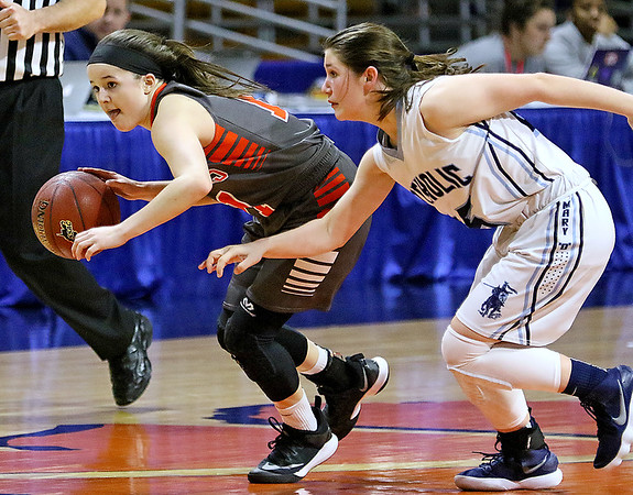(Brad Davis/The Register-Herald) Summers County's Taylor Isaac works across mid court looking for open teammates as Parkersburg Catholic's Jenna Boice defends Thursday night at the Charleston Civic Center.