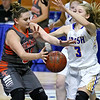 (Brad Davis/The Register-Herald) Summers County's Erica Merrill battles for a loose ball with St. Joseph Central's Laney Whitmore Friday night at the Charleston Civic Center.