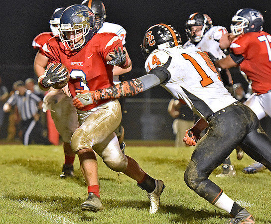 (Brad Davis/The Register-Herald) Independence's Mason Kump carries the ball as Summers County's Christian Pack tries to bring him down Friday night in Coal City.