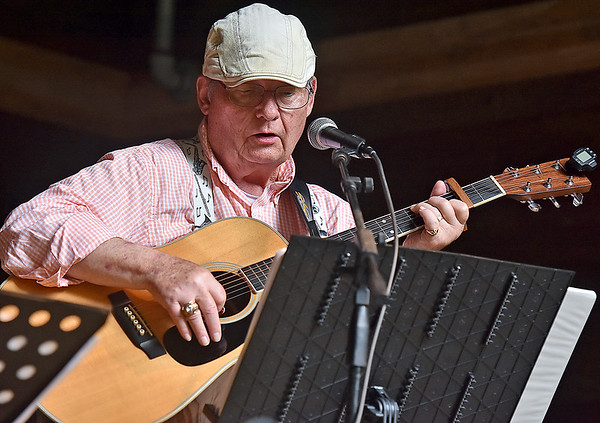 (Brad Davis/The Register-Herald) Hurricane musician Mike Shawler performs during a day of tunes and hanging out at the Chimney Corner Cafe & Amphitheater Sunday afternoon near Ansted.