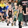 (Brad Davis/The Register-Herald) Young wrestlers from all over the state make their entrances Sunday afternoon at Beckley-Raleigh County Convention Center.