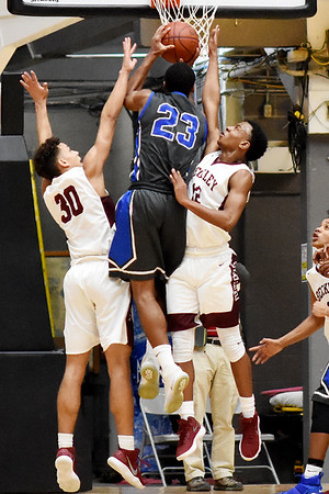 Woodrow hosted Capital during their basketball sectional championship against Capital Tuesday in Beckley. (Chris Jackson/The Register-Herald)