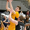 (Brad Davis/The Register-Herald) WVU Tech's Michael Scott drives to the basket as IU-East's Lucas Huffman defends Saturday afternoon at the Beckley-Raleigh County Convention Center.
