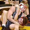 (Brad Davis/The Register-Herald) Liberty's Davy Stoots takes on Braxton County's Tyee Ellyson is a 120-pound weight class matchup Friday night at the Summersville Arena and Convention Center. Liberty's Stoots would win the match.