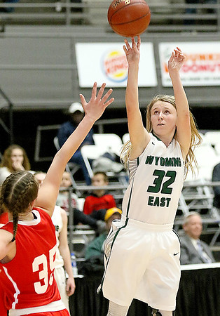 (Brad Davis/The Register-Herald) Wyoming East's Gabby Lupardus pulls up for a jump shot as Parkersburg's Madi Mace defends during Big Atlantic Classic action Wednesday night at the Beckley-Raleigh County Convention Center.