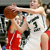 (Brad Davis/The Register-Herald) Wyoming East's Kara Sandy drives to the basket as Parkersburg's Maggie Richards defends during Big Atlantic Classic action Wednesday night at the Beckley-Raleigh County Convention Center.