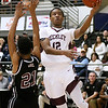 (Brad Davis/The Register-Herald) Woodrow Wilson's Tyriek Walton drives and scores as Bluefield's Dominick Taxely defends during the Little General Battle for the Armory Tournament Thursday night at the Beckley-Raleigh County Convention Center.