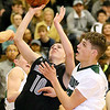 (Brad Davis/The Register-Herald) Westside's Isaiah Lester cuts between Wyoming East defenders Evan Preece (out of the frame at left) and Jacob Bishop (right) to score Saturday night in New Richmond.