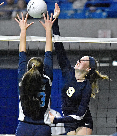 (Brad Davis/The Register-Herald) Shady Spring's Olivia Barnett spikes the ball as Philip Barbour's Riley Domingues tries to block during State Volleyball Tournament action Friday evening at the Charleston Civic Center.