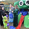 (Brad Davis/The Register-Herald) Costumed trunk or treaters pass by the frog-costumed vehicle of Summit Community Bank's Jessica Ratchford (princess) and Tammy Pemberton (frog) during the West Virginia Miners' Trunk or Treat event Sunday afternoon at Linda K. Epling Stadium.