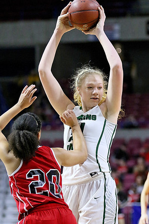 (Brad Davis/The Register-Herald) Wyoming East's Emily Saunders keeps the ball away from Wayne's Jamalyn Ray as she looks for an open teammate Friday morning at the Charleston Civic Center.