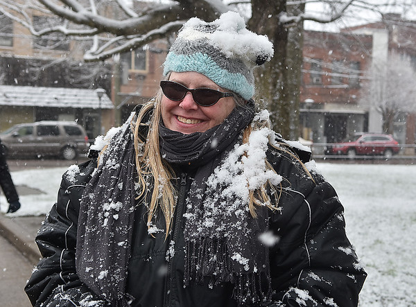(Brad Davis/The Register-Herald) Bluefield resident Alice Kailbourn begins to morph into a living snowman after participating in Saturday's March For Our Lives rally at Beckley's Shoemaker Square as a fresh round of snow coats the area.