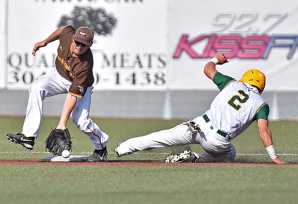 (Brad Davis/The Register-Herald) Miners baserunner Colby Johnson slides into 2nd for one of two steals on the day as Kokomo infielder Neil Lambert scoops up the late throw Sunday afternoon at Linda K. Epling Stadium.