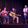 (Brad Davis/The Register-Herald) Singer Jeff Burgess and band members (from left) Mike Burgess, Blair Frias and Matt Gross, perform during the Friends on New River Gorge Songwriters Showcase Saturday night at the Historic Fayette Theater. The event featured at least 10 band and solo performances by musicians from across the area who paid homage to the Mountain State through song.