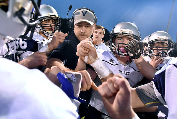(Brad Davis/The Register-Herald) Valley players and coaches come together for one last fist bump prior to kickoff Friday night in Meadow Bridge.