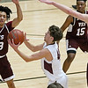 (Brad Davis/The Register-Herald) Woodrow Wilson's Danny Bickey drives to the basket as Virginia Episcopal defenders Jaelin Llewellyn, left, and Michael Caprise, far right, converge on him during the Little General Battle for the Armory Tournament Friday night at the Beckley-Raleigh County Convention Center.