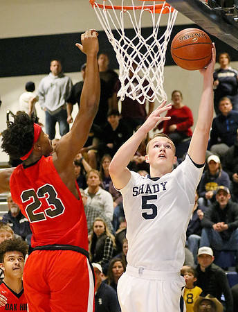 (Brad Davis/The Register-Herald) Shady Spring's Steven Williams drives and scores as Oak Hill's Andrew Work defends during the Tigers' win over the Red Devils Thursday night in Shady Spring.
