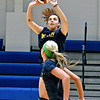 (Brad Davis/The Register-Herald) WVU Tech volleyball player Konstantina Pateli sets the ball for teammate Emily Kidd, near, as she leaps to spike it during practice Wednesday evening inside the Van Meter Gymnasium.