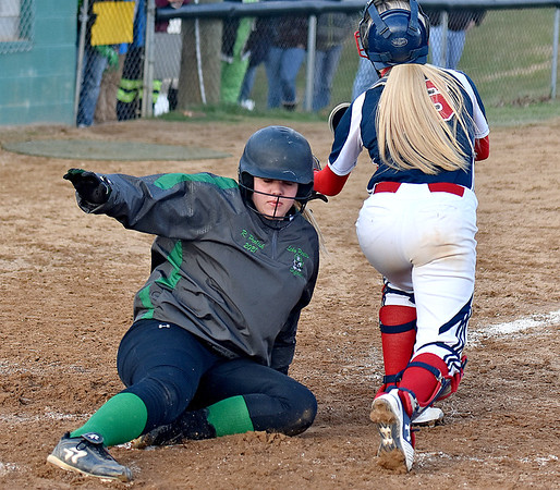(Brad Davis/The Register-Herald) Fayetteville's Rachel Peelish slides home as the tag comes late from Independence catcher Riley Adkins Wednesday evening at Fayetteville Town Park.