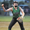 (Brad Davis/The Register-Herald) Fayetteville starting pitcher Ashley Fridley reacts after striking out the last Cavalier batter as the Lady Pirates celebrate a victory after a wild, 8 inning, 22-14 rain-soaked thriller against Greenbrier West Wednesday night at Huse Park in Fayetteville.
