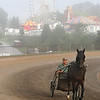 A rider rides around the track in the early morning at the State Fair of West Virginia Friday. (Jenny Harnish/The Register-Herald)